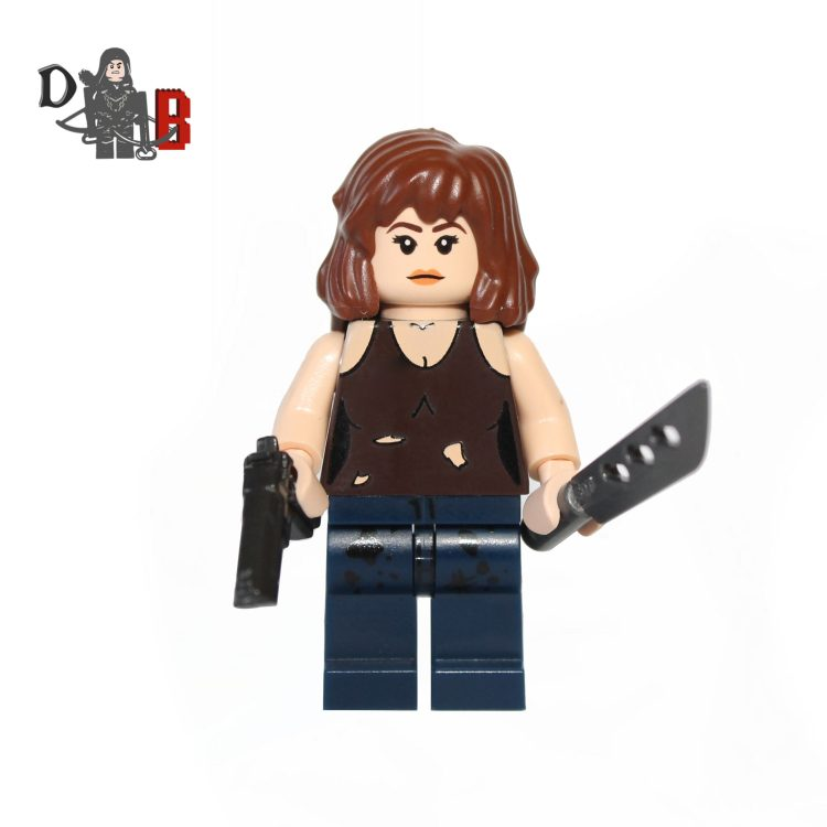 "This custom designed Minifigure is based upon Maggie Greene from the popular Walking Dead Series. Includes Maggie's machete and pistol. The chest has been professionally machine printed using my own design. Made using genuine LEGO parts except for the machete and pistol which are professionally custom made. Each minifigure is carefully packaged into a re-sealable bag and shipped in a bubble lined envelope for extra protection. ""LEGO® is a trademark of the LEGO Group of companies. The LEGO Group does not sponsor, authorise or endorse the modified/customised product(s) shown nor does it accept responsibility in any way, shape or form for any unforeseen and/pr adverse consequences following from such customisation/modification."""