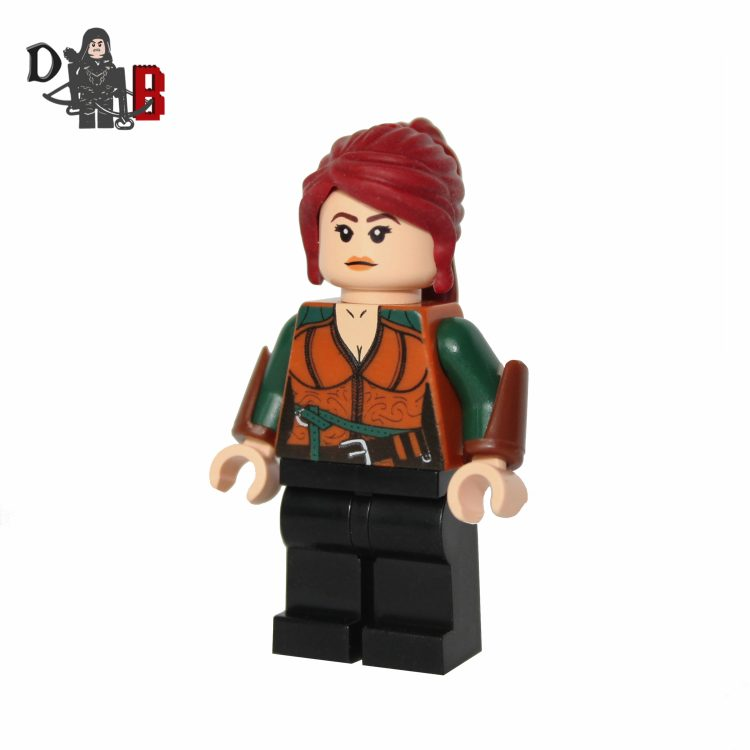 "This custom designed Minifigure is based upon Triss Merigold from the popular Witcher Series. Includes hand attachment with flame. The chest has been designed by me and permanently machine printed on. Made using genuine LEGO parts except for the vambraces which have been professionally custom made. Each Minifigure is carefully packaged into a re-sealable bag and shipped in a bubble lined envelope for extra protection. ""LEGO® is a trademark of the LEGO Group of companies. The LEGO Group does not sponsor, authorise or endorse the modified/customised product(s) shown nor does it accept responsibility in any way, shape or form for any unforeseen and/pr adverse consequences following from such customisation/modification."""